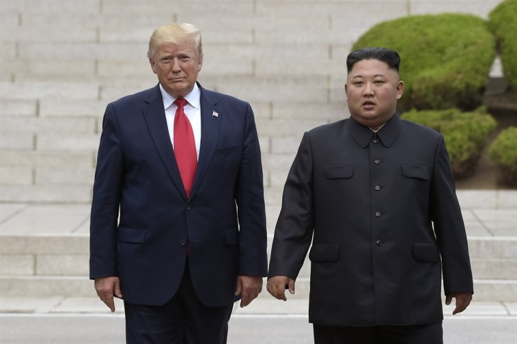 In this June 30, 2019, file photo, U.S. President Donald Trump, left, meets with North Korean leader Kim Jong-un at the North Korean side of the border at the village of Panmunjom in Demilitarized Zone. Journalist Bob Woodward's book, 'Rage,' includes new details about Trump's comments on Kim. AP