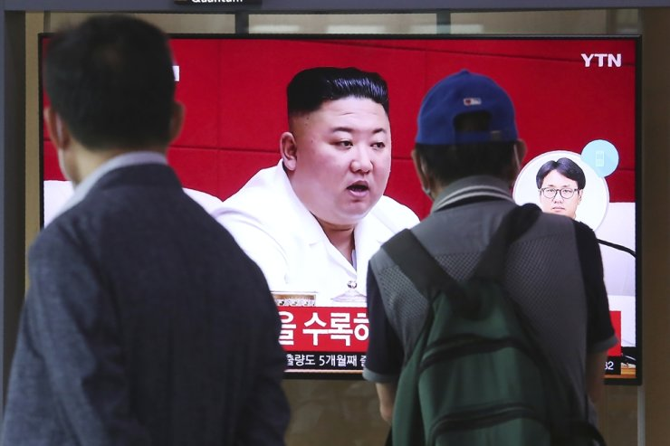 People watch a screen showing a file image of North Korean leader Kim Jong Un during a news program at the Seoul Railway Station in Seoul, Sept. 25, 2020. AP