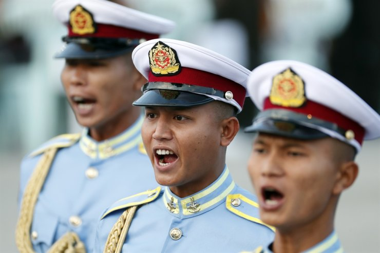 In this Jan. 4, 2020, file photo, high-ranking soldiers shout commands during a ceremony to mark the 72nd anniversary of Independence Day in Naypyitaw, Myanmar. The overwhelming control of Myanmar's economy by the military through some of its biggest companies means its foreign and domestic business partners are likely supporting military units and leaders suspected of human rights abuses, critics say. AP