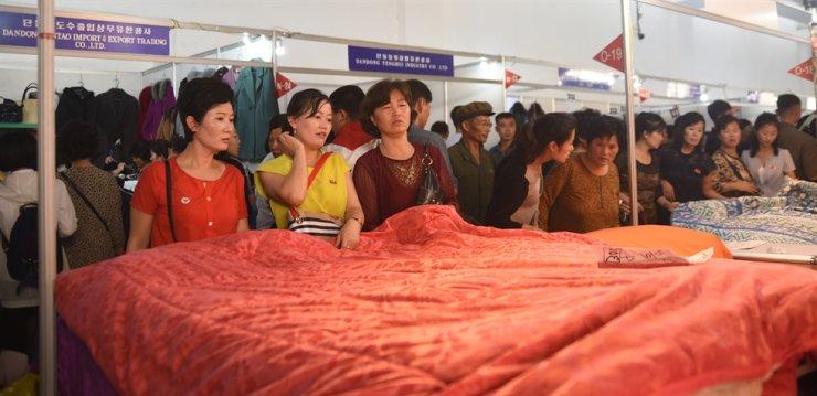 Women shop for Chinese goods at the Pyongyang International Autumn Trade Fair in September 2018. / Korea Times photo by Jon Dunbar