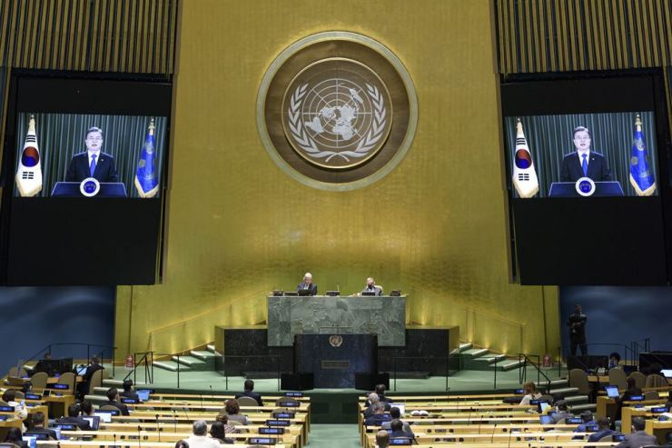 South Korean President Moon Jae-in (on the screens) addresses the general debate of the 75th session of the United Nations General Assembly via video at the U.N. headquarters in New York, on Sept. 22. Xinhua-Yonhap