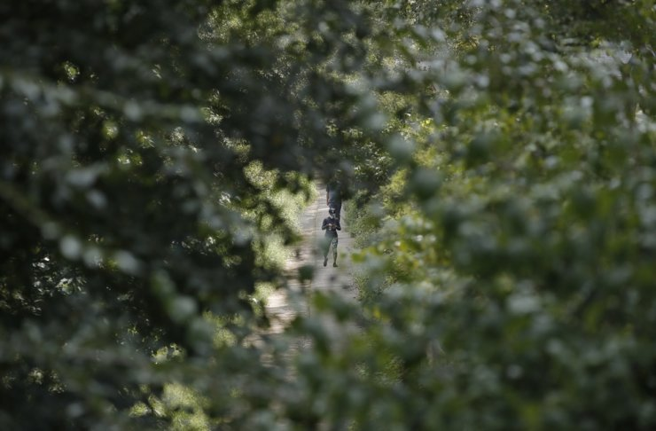 A visitor wearing a face mask as a precaution against the coronavirus, walks along a stream in Seoul, Thursday, Sept. 10, 2020. AP