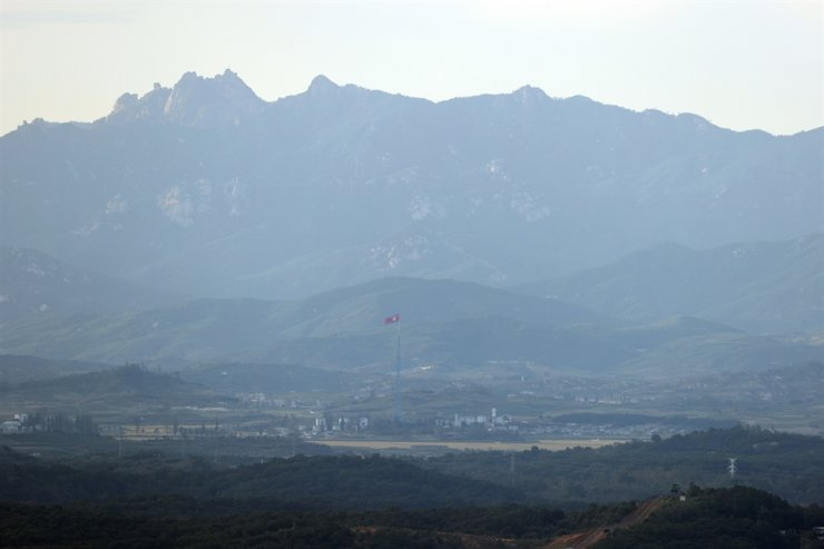 A North Korean flag is seen from Paju, South Korea, Thursday. According to Coast Guard, a South Korean official who was shot dead by North Korean soldiers earlier this week left no indication of an attempt to defect to the North. Yonhap