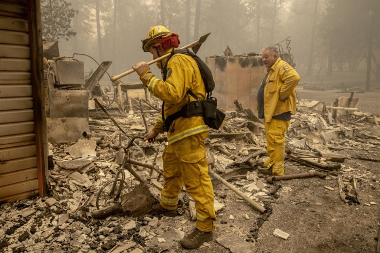 Volunteer firefighters check remains of Fire Station 61 after it was destroyed by the Bear fire, part of the North Complex fires, in Berry Creek, California, Saturday. /EPA
