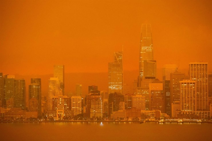 The San Francisco skyline is obscured in orange smoke and haze as their seen from Treasure Island in San Francisco, California on September 9, 2020. /AFP