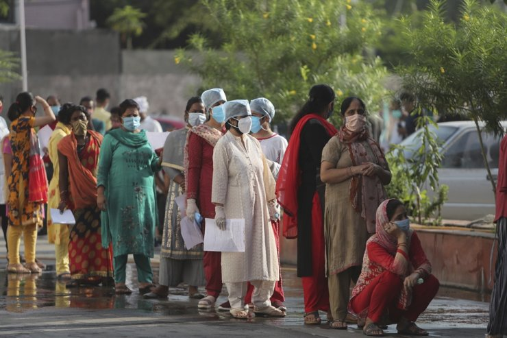 People wait in a queue to register their names to have their nasal swab samples taken to test for COVID-19 in Jammu, India, Tuesday, Sept. 15, 2020. India's coronavirus cases are now the second-highest in the world and only behind the United States. AP