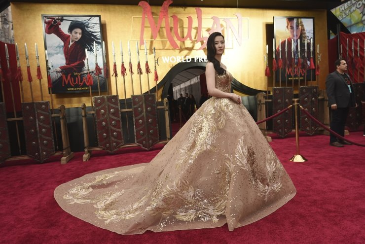 In this March 9, 2020, file photo, Yifei Liu, star of the new live-action 'Mulan,' poses at the premiere of the film at the El Capitan Theatre in Los Angeles. Disney is under fire for filming part of its live-action reboot