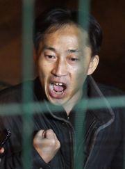 Ri Jong-chol talks to reporters from inside the North Korean Embassy in Beijing, Saturday. Yonhap