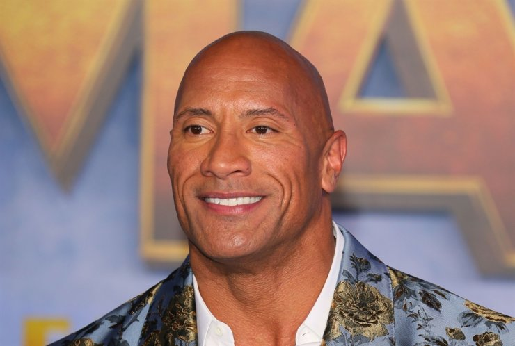 In this file photo taken on Dec. 9, 2019, actor Dwayne Johnson arrives for the World Premiere of 'Jumanji: The Next Level' at the TCL Chinese theatre in Hollywood. Dwayne 'The Rock' Johnson and his entire family tested positive for coronavirus, he said on Sept. 2, 2020. AFP