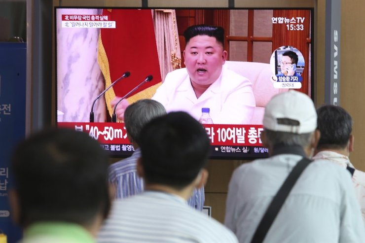 People watch a screen showing a file image of North Korean leader Kim Jong Un during a news program at the Seoul Railway Station in Seoul, South Korea, Friday, Sept. 25, 2020. AP
