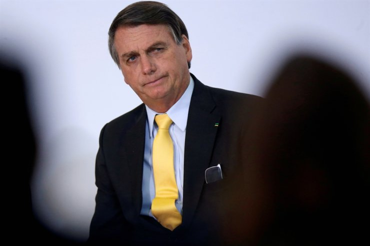 Brazil's President Jair Bolsonaro looks on during the COVID-19 Clinical Study Result Announcement Ceremony at the Planalto Palace in Brasilia, Brazil, Oct. 19, 2020. Reuters