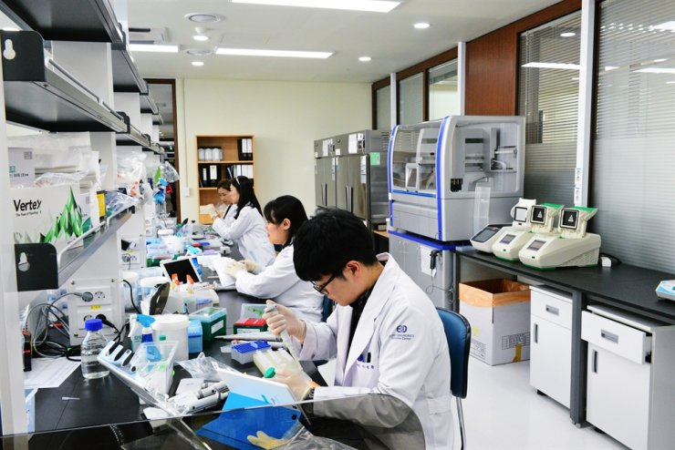 Researchers work in a lab at EDGC headquarters in Incheon. Courtesy of EDGC