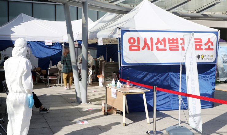 South Korea's new COVID-19 infections returned to below 100, Friday, after triple-digit infections were reported for the previous two days, as sporadic infection clusters continued at elderly care hospitals and other risk-prone facilities. Yonhap