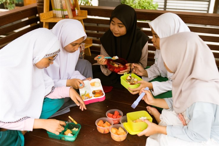 Adolescents in Surabaya in Indonesia's East Java Province. Haddad argues that the youths are future business clients and future voters and must raise their voices to improve the world's food systems. Courtesy of Lawrence Haddad
