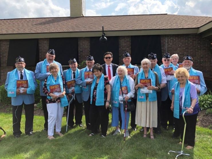 Han Jong-woo, back row fifth from left, president of the Korean War Legacy Foundation, poses with Korean War veterans and their family members at the Central New York Chapter #105 in Syracuse after the foundation published its first history book about the war, in this June 2019 photo. / Courtesy of Han Jong-woo