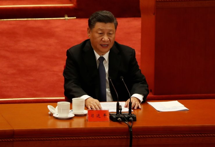China's President Xi Jinping speaks while taking part in an event marking the 70th anniversary of the Chinese People's Volunteer Army's participation in the Korean War at the Great Hall of the People in Beijing, China October 23, 2020. REUTERS-Yonhap