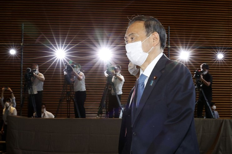 In this Sept. 16, 2020, file photo, Yoshihide Suga arrives at the prime minister's office after being formally elected Japan's prime minister in a parliamentary vote in Tokyo. Suga heads to Vietnam and Indonesia on Oct. 18 on his first overseas foray since taking over from his former boss Shinzo Abe last month. AP