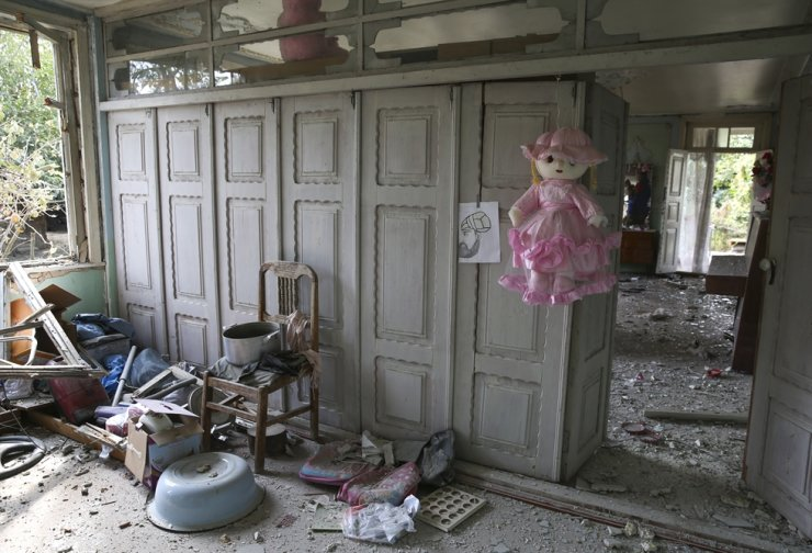 Damage is seen inside an apartment building that was allegedly damaged by recent shelling during fighting over the breakaway region of Nagorno-Karabakh in Tartar region, Azerbaijan, Wednesday, Sept. 30, 2020. AP