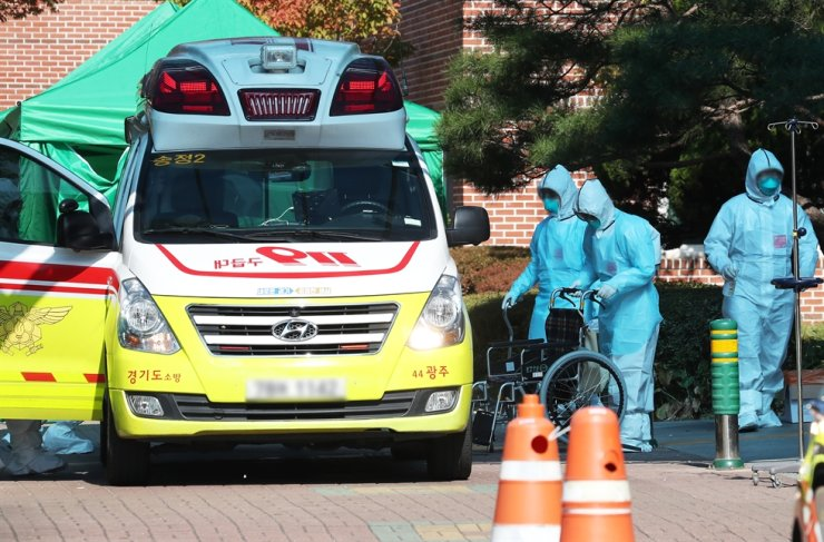 Health officials wearing protective suits work at a rehabilitation hospital in Gwangju, Gyeonggi Province, Sunday, as more than 50 COVID-19 patients have been reported there. / Yonhap