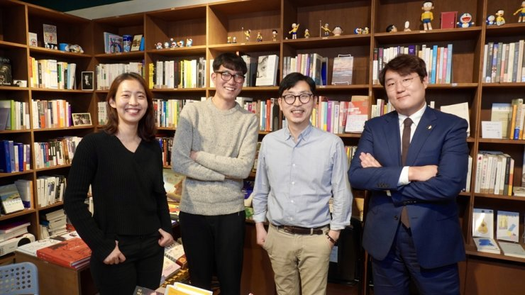Nho Myung-woo, third from left, a sociology professor at Ajou University and owner of Bookshop Nieun poses with three booktenders at the bookstore. / Courtesy of KL Publishing