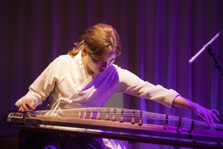 Yoon Da-young of CelloGayageum plays gayageum (Korean 12-string zither) at Jeongdong Theater. Courtesy of Jeongdong Theater