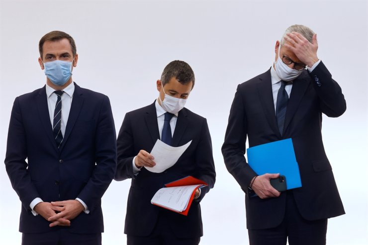 French Health Minister Olivier Veran, left, French Interior Minister Gerald Darmanin, center, and French Economy and Finance Minister Bruno Le Maire attend a press conference to present the details of new restrictions aimed at curbing the spread of the COVID-19 pandemic, Thursday, Oct.15, 2020, in Paris. AP
