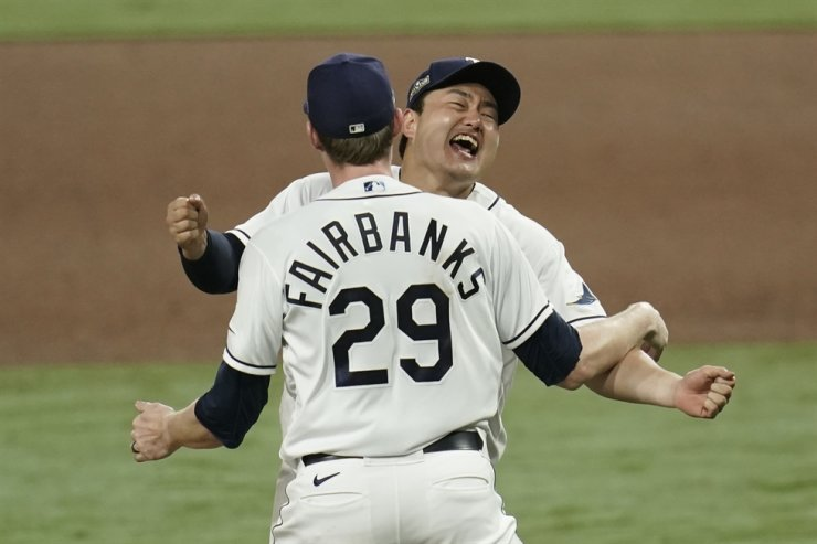 Tampa Bay Rays pitcher Peter Fairbanks and Ji-Man Choi celebrate their victory against the Houston Astros in Game 7 of a baseball American League Championship Series, Saturday, Oct. 17, 2020, in San Diego. AP