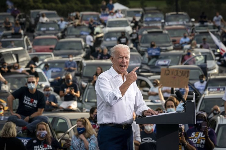 Democratic presidential nominee Joe Biden speaks during a drive-in campaign rally in the parking lot of Cellairis Ampitheatre on October 27, 2020 in Atlanta, Georgia. /AFP