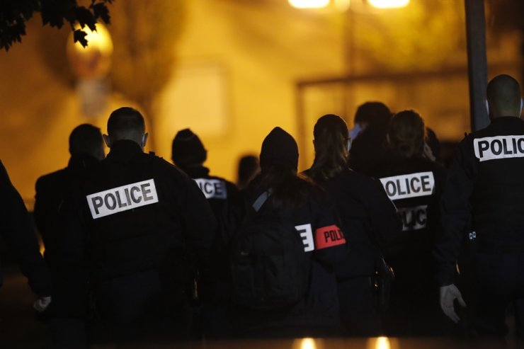 French police officers gather outside a high school in Conflans-Saint-Honorine, north of Paris, after a history teacher there who opened a discussion with students on caricatures of Islam's Prophet Muhammad was beheaded, Friday. AP