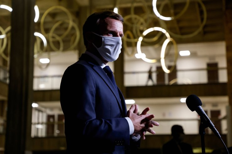 French President Emmanuel Macron wearing a face mask delivers a speech at the end of a visit about the fight against separatism at the Seine-Saint-Denis prefecture headquarters in Bobigny, near Paris, Oct. 20, 2020. Reuters