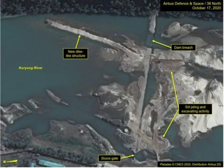 This satellite image, taken by Airbus Defence & Space, Oct. 17, and published by 38 North, Oct. 22, shows repair work at a reservoir overflow dam used to maintain a constant source of water for the cooling systems of North Korea's nuclear reactors in Yongbyon. Yonhap