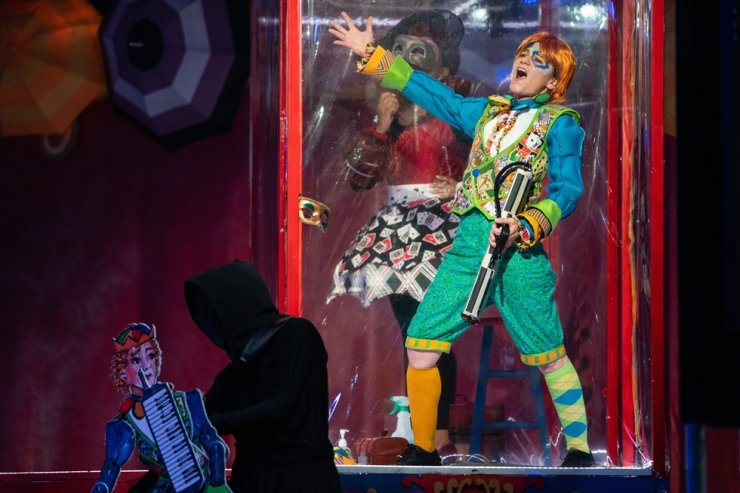 A woman sings inside a plastic box on stage during The Atlanta Opera's production of 'Pagliacci' on Oct. 22, 2020, in Atlanta, Georgia. AFP