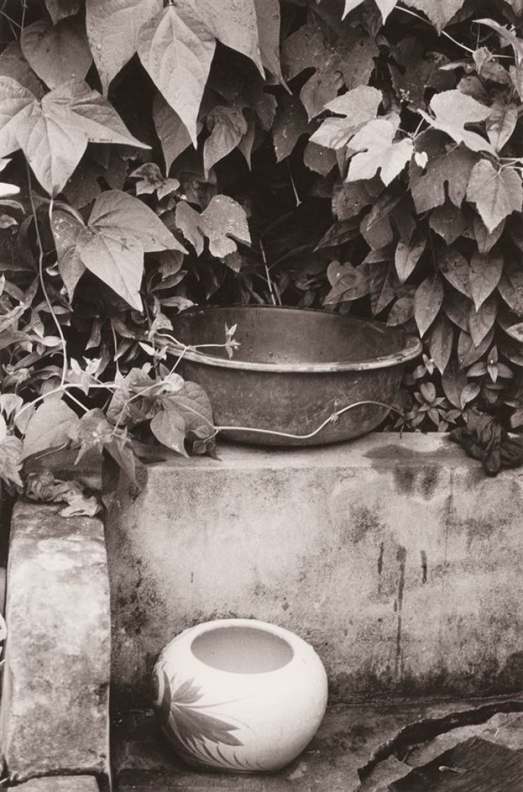 Yogang, below, a portable toilet, is seen in this 1980 photo taken in Seongju County, North Gyeongsang Province. / Courtesy of Noonbit Publishing house
