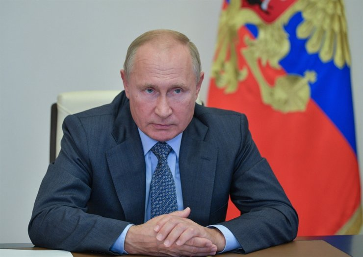 Russian President Vladimir Putin chairs a meeting at Novo-Ogaryovo residence, outside Moscow, on Oct. 8, 2020. AFP