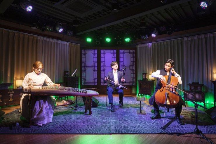 From left, gayageum player Yoon Da-young, haegeum player Mun Saehanbyeol and cellist Sol Daniel Kim perform