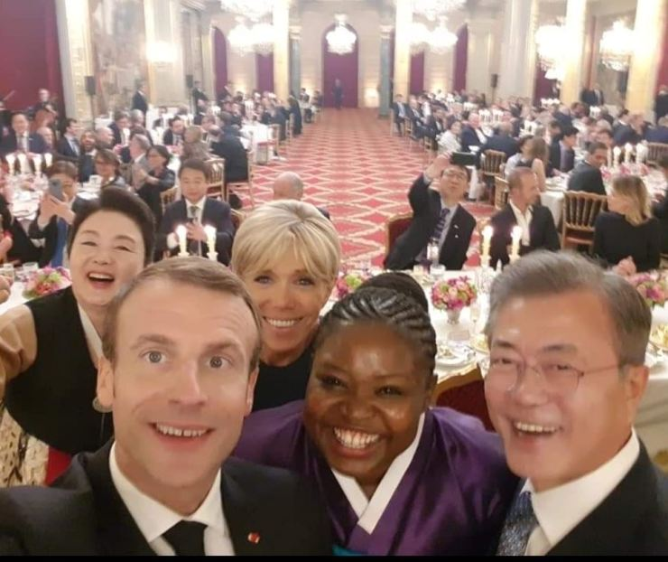 Laure Mafo, center, takes a picture with French President Emmanuel Macron and Korean President Moon Jae-in after performing pansori at the Elysee Palace in 2018. Courtesy of Laure Mafo