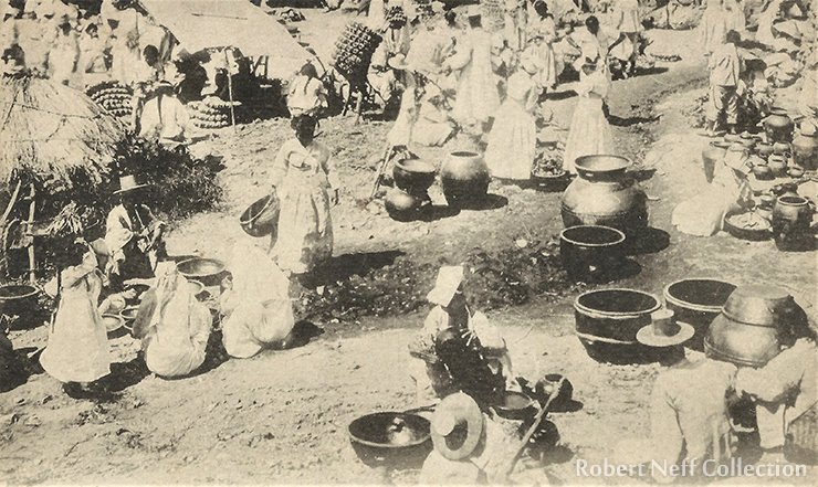 Pottery and clay ware on display in the market. Robert Neff Collection
