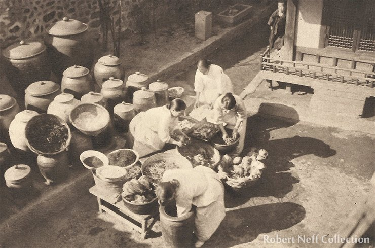 Women making kimchi in the family courtyard. Robert Neff Collection