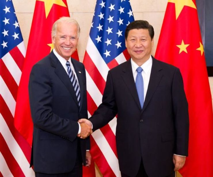 Joe Biden, then U.S. vice president, shakes hands with Chinese President Xi Jinping during his visit to Beijing in this August 2011 photo. / Yonhap