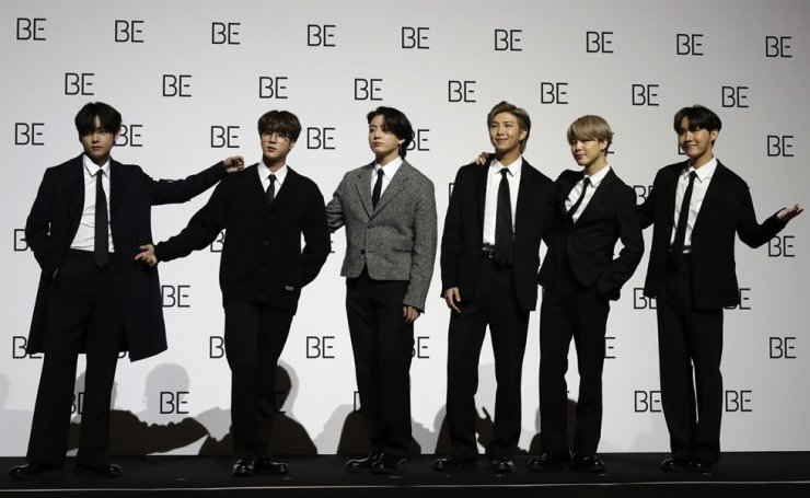 Members of K-pop band BTS pose for photographers during a press conference to introduce their new album 'BE' in Seoul, Nov. 20. AP