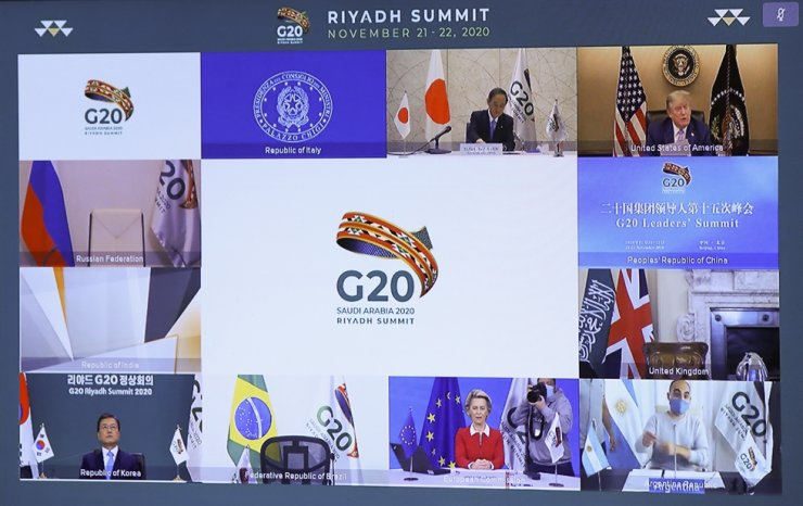 U.S. President Donald Trump, European Commission President Ursula von der Leyen, Japan's Prime Minister Yoshihide Suga and South Korean President Moon Jae-in are seen on a screen before the start of the virtual G20 meeting hosted by Saudi Arabia, amid the coronavirus disease (COVID-19) outbreak, in Brussels, Belgium November 21, 2020. EPA-Yonhap