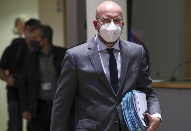 European Council President Charles Michel wears a protective face mask as he arrives to participate in a virtual G20 meeting, hosted by Saudi Arabia, at the European Council building in Brussels, Saturday, Nov. 21, 2020. AP