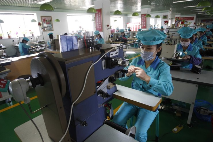 Employees assemble leather shoes at the Wonsan Leather Shoes Factory in Wonsan, Kangwon Province, North Korea, Oct. 28, 2020. AP