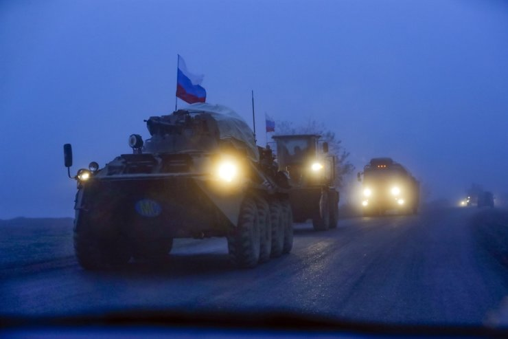 Russian peacekeepers' military vehicles with Russian national flags roll along a highway at the separatist region of Nagorno-Karabakh, Nov. 19. AP