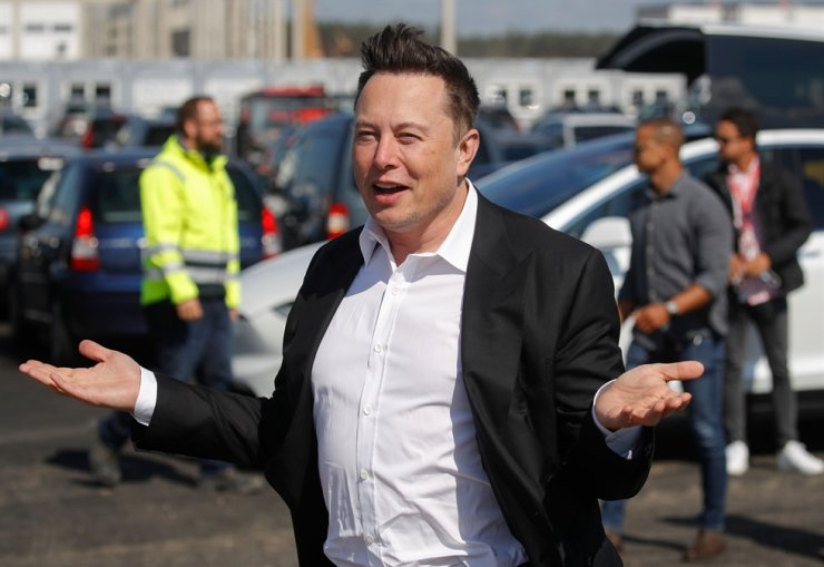 This file photo taken on Sept. 3, 2020, shows Tesla CEO Elon Musk gesturing as he arrives to visit the construction site of the future U.S. electric car giant Tesla, in Gruenheide near Berlin. AFP