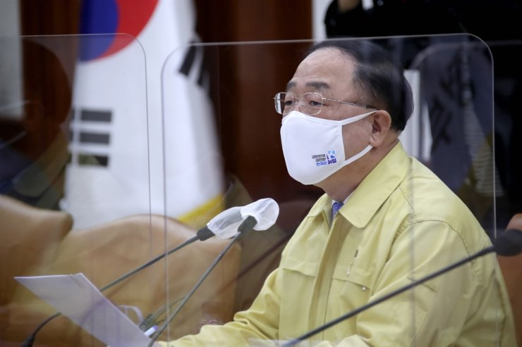 Finance Minister Hong Nam-ki speaks during a meeting on the government's emergency response for the economy at the government complex in Seoul, Thursday. Yonhap
