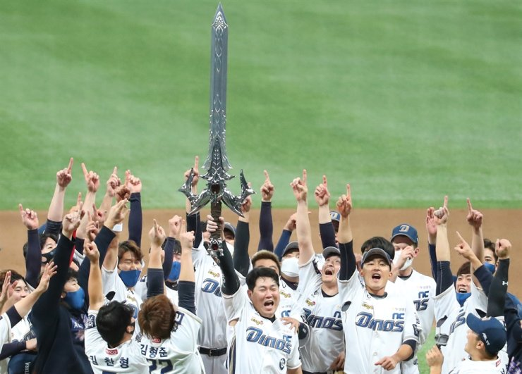 NC Dinos players celebrate with a giant sword after winning the 2020 Korean Series against the Doosan Bears in Game 6 at Gocheok Sky Dome in Seoul, Tuesday, Nov. 24, 2020. Yonhap
