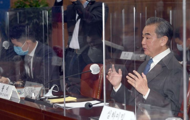 Chinese State Councilor and Foreign Minister Wang Yi speaks during a meeting with Foreign Minister Kang Kyung-wha at the Ministry of Foreign Affairs headquarters in central Seoul, Thursday. Yonhap