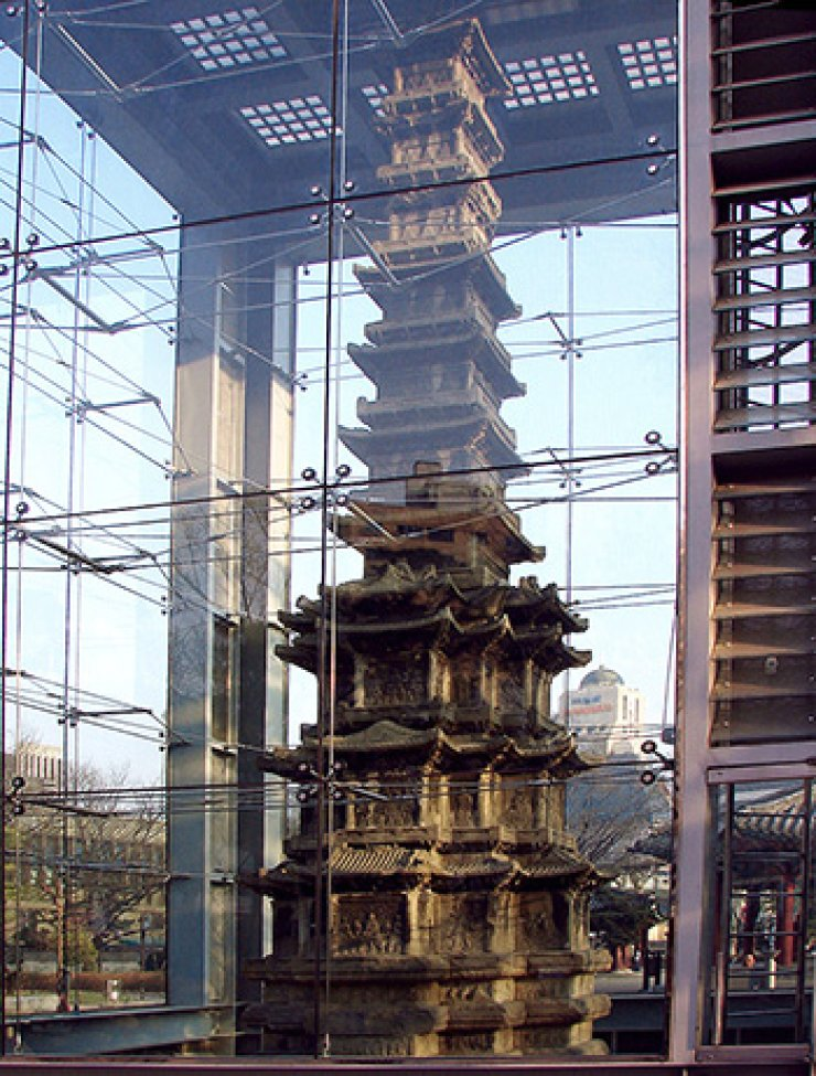 Wongaksa Pagoda as it is now ― in a glass box. Wikipedia image ― photo-credit
