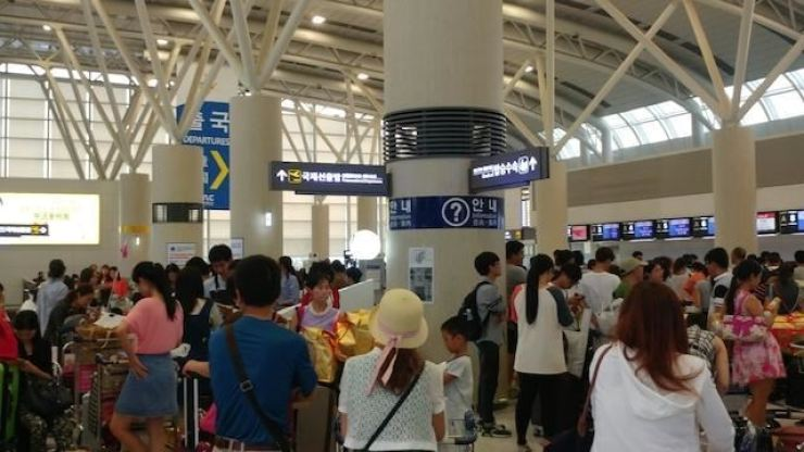 The terminal at Jeju International Airport is crowded with tourists in this file photo taken before the coronavirus outbreak. / Korea Times file